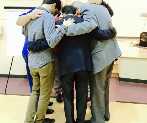 circle of men praying